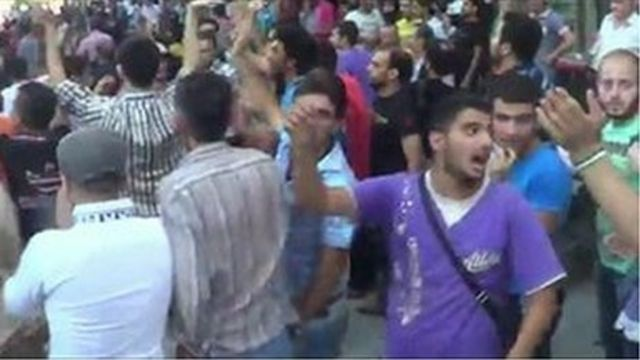YouTube clip said to be taken in Garden Palace area of Aleppo on 9 July showing crowds calling for the end of the siege.