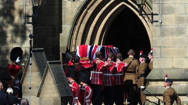 The coffin of Fusilier Lee Rigby is carried into Bury Parish Church for an overnight vigil