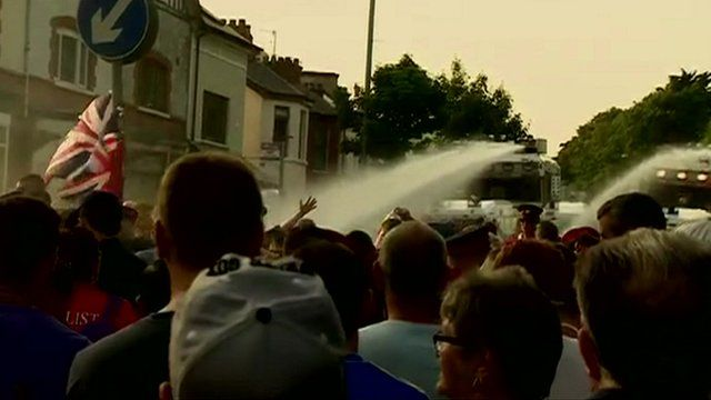 Water cannon being used