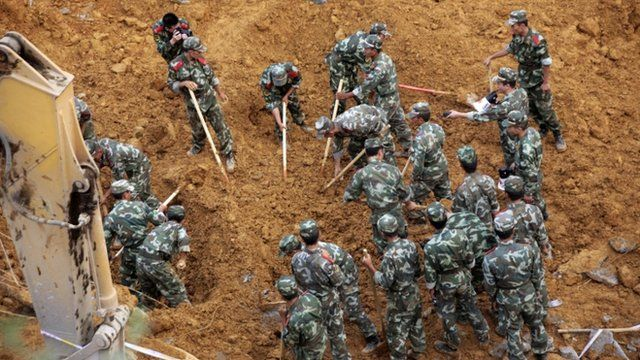 Rescuers look for landslide victims in Bijie, southwest Chinas Guizhou province