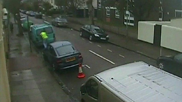 Man breaking into a van