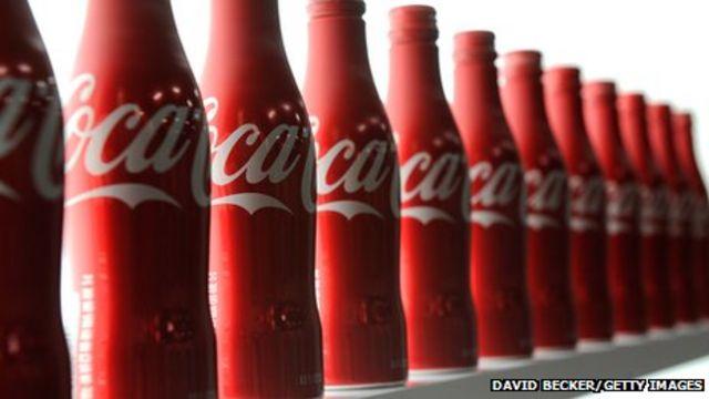 Coca-Cola sees earnings drop as sales fall in US