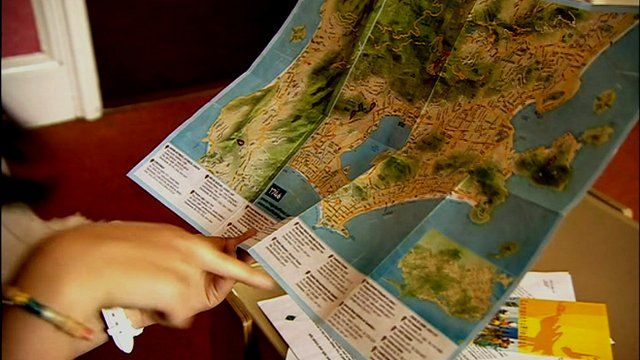 Pilgrims check out a map of Brazil