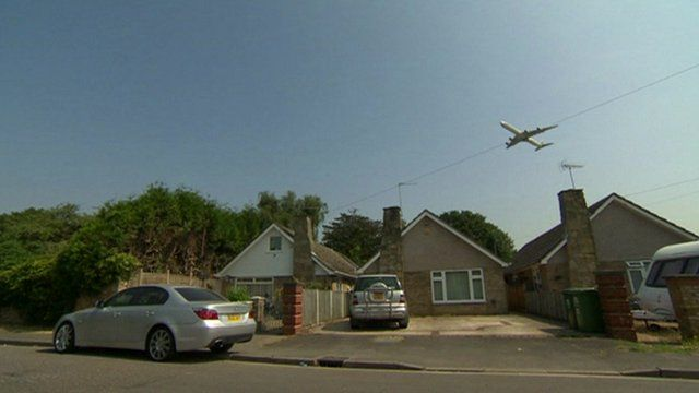 Plane flying over homes