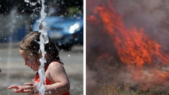 Olivia Currie, aged 2, enjoys a water fountain in Folkestone, Kent, while a fire burns on Mitcham Common in south London
