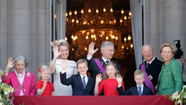 Queen Fabiola of Belgium, Princess Eleonore of Belgium, Prince Gabriel of Belgium, Queen Mathilde of Belgium ,Princess Elisabeth of Belgium, King Philippe of Belgium, Prince Emmanuel of Belgium, Prince Albert II of Belgium and Princess Paola of Belgium are seen greeting the audience from the balcony of the Royal Palace