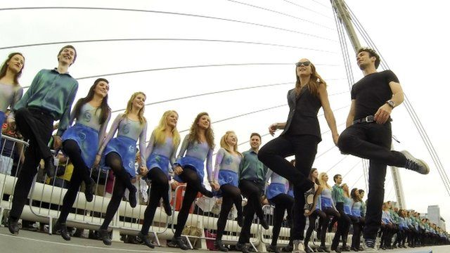 Jean Butler and Padraic Moyles lead the cast of Riverdance on Samuel Beckett Bridge