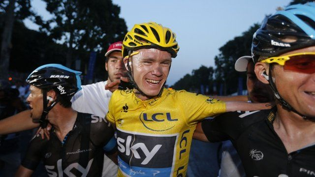 """Tour de France 2013 winner Britain""""s Christopher Froome (C) celebrates with teammates on the Champs-Elysee avenue in Paris"""