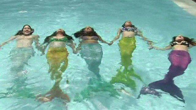 Women and girls wear mono-tails and swim like mermaids
