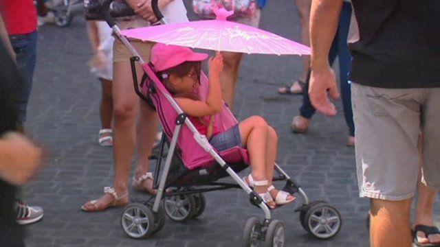 Girl in pushchair