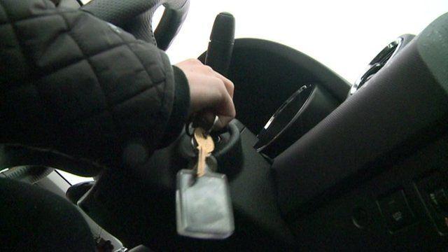 Driver inserting car keys