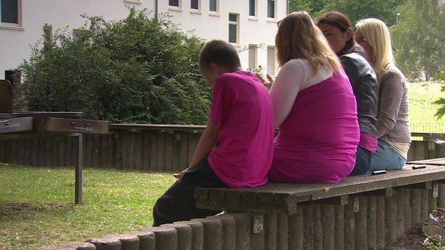 People sat on bench
