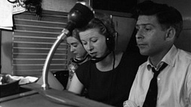 Barbara Chambers, Mary Evans and Ray Butt at the controls in the BBC Mobile Control Van outside the Stage Door of the Whitehall Theatre, 1960