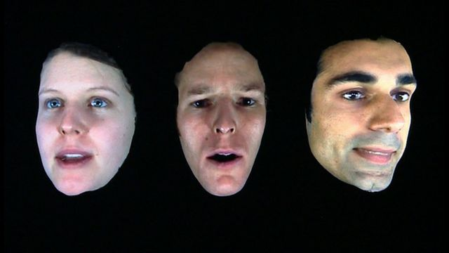 3D graphic of three faces
