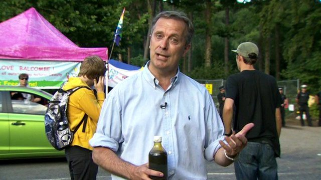 BBC Correspondent Duncan Kennedy displays a bottle of oil drilled from the Balcombe site in Sussex.