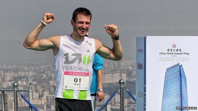 Thomas Dold at top of China World Tower