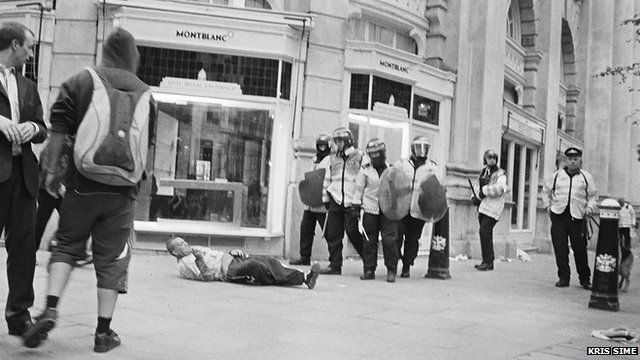 Ian Tomlinson lying on the ground (picture: Kris Sime)