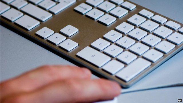 Man using computer keyboard