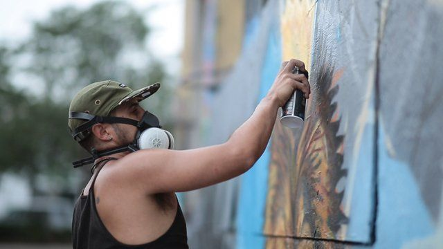 A graffiti artist spraying paint