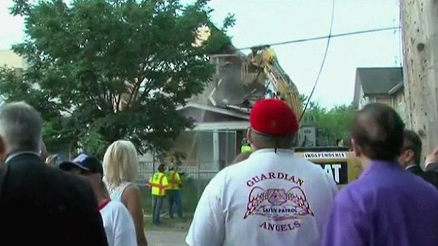Spectators watch as Ariel Castro's house is demolished