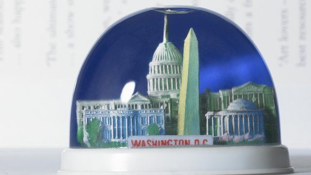 A snow globe containing famous Washington landmarks