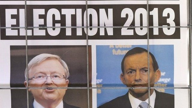 Newspaper advertisement with pictures of Australian Prime Minister Kevin Rudd and opposition leader Tony Abbott