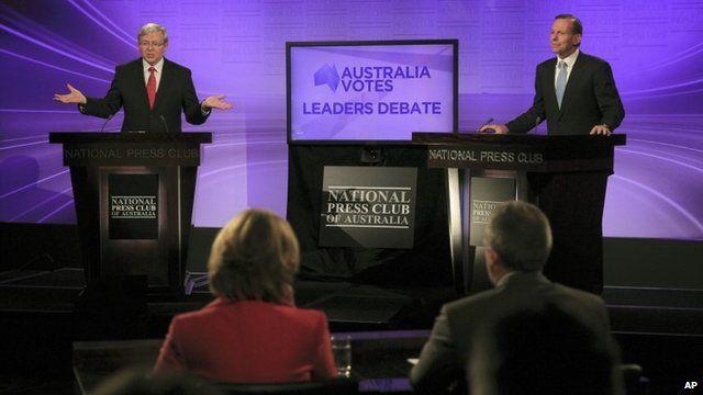 Australia's Prime Minister Kevin Rudd, left, and opposition leader Tony Abbott