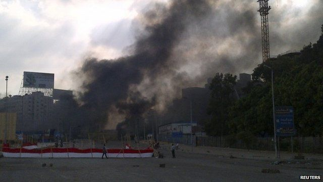Smoke rises during clashes between riot police and members and supporters of the Muslim Brotherhood, at Rabba el Adwia Square in Cairo