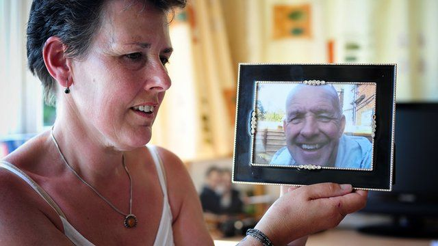 Tanya with a photo of her murdered husband Gary