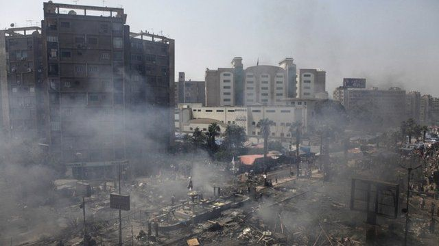 Plumes of smoke rise from the site of a protest in support of deposed Egyptian President Mohammed Morsi during a violent crackdown by Egyptian Security Forces on a pro-Morsi sit-in demonstration at the Rabaa al-Adweya Mosque in the Nasr City, Cairo, Egypt