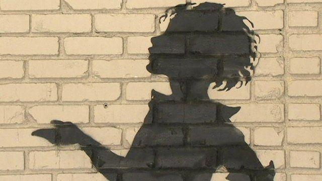 Banksy's Flower Girl