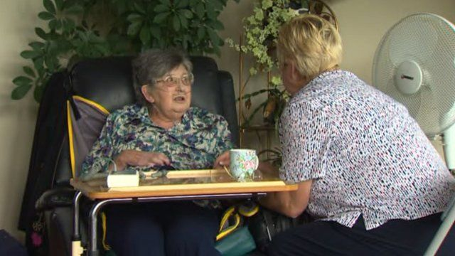 Margaret Robinson with a carer