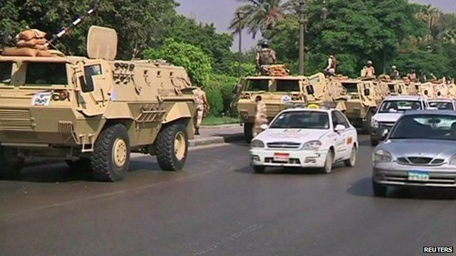 Egyptian military and cars on a road