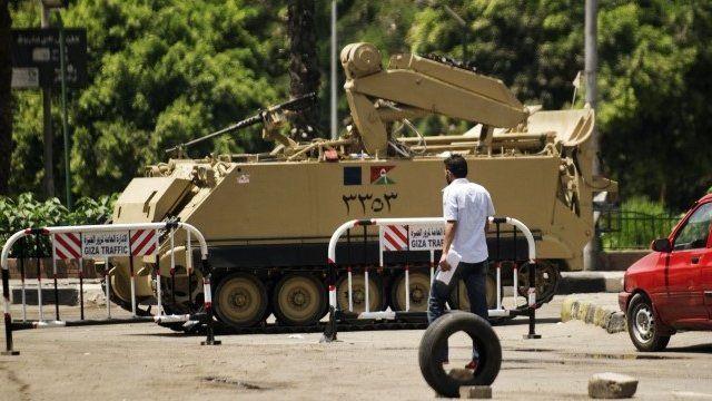 Egyptian armoured vehicle outside Saudi Arabian embassy in Cairo
