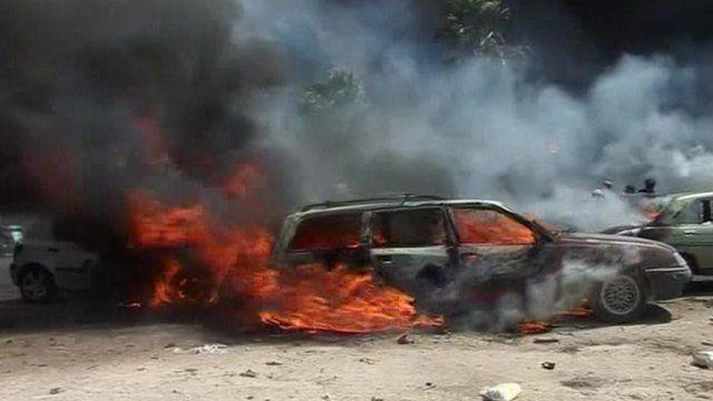 Car on fire in Tripoli following explosions