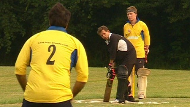 Mike Bushell with a cricket bat