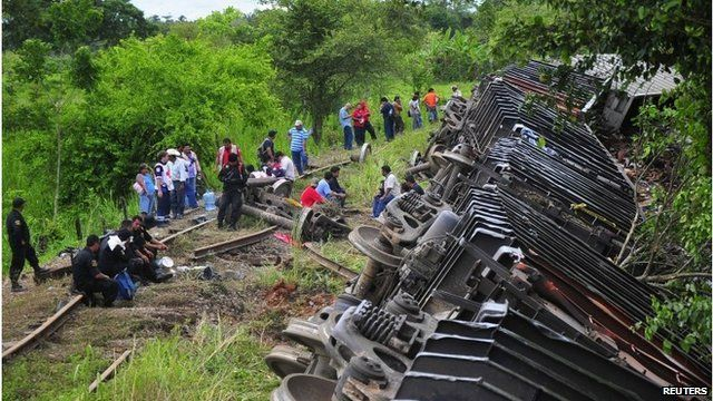 Overturned carriages of a derailed train in Huimanguillo, in the Mexican state of Tabasco