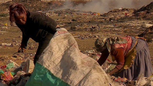 People scavenging on rubbish dump