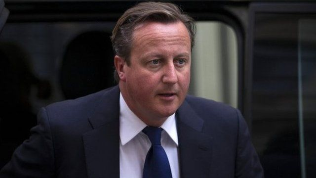 British Prime Minister David Cameron arrives at 10 Downing Street