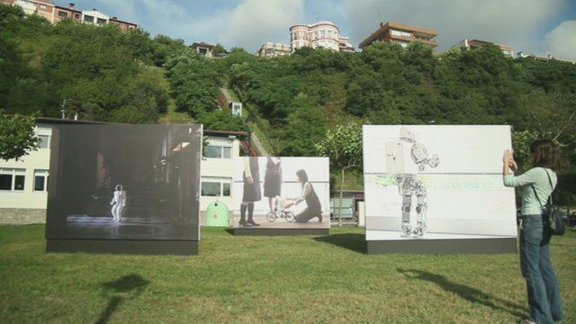 Photographs displayed on a lawn in Getxo