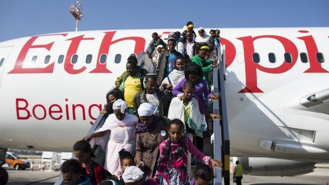 New Jewish immigrants walking down the airplane during a welcoming ceremony after arriving on a flight from Ethiopia