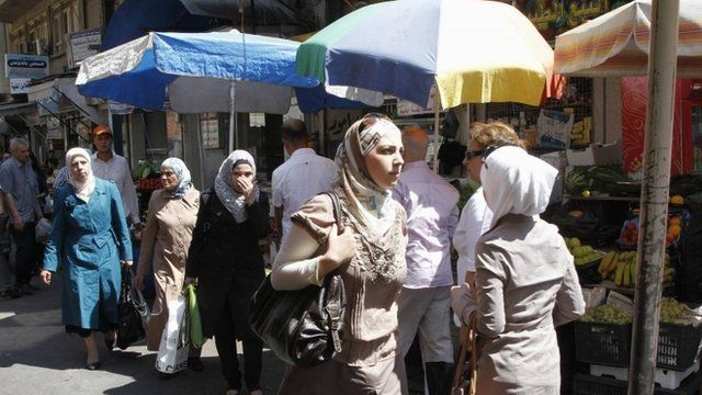 Syrians shop at al-Shaalan market in Damascus August 28, 2013