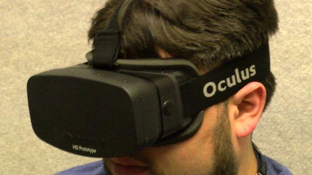 A man wearing an Oculus Rift headset