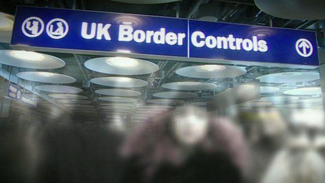 A blue sign reading 'UK Border Controls'
