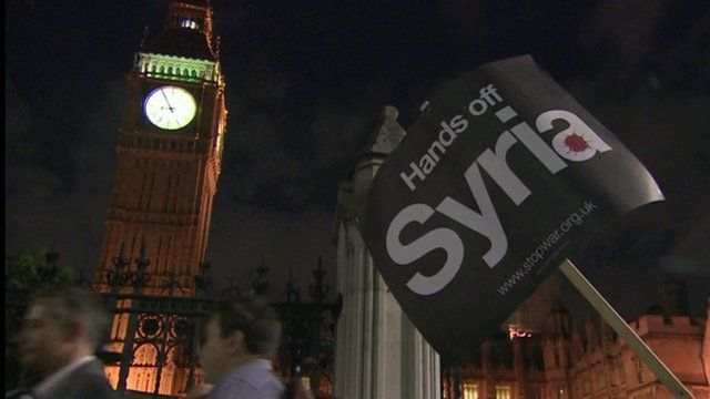 Placard reading 'Hands off Syria' outside Big Ben