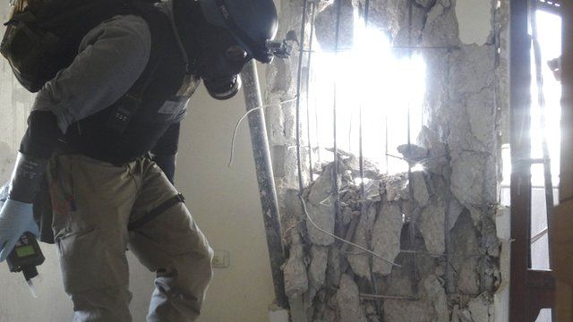 A UN chemical weapons expert inspects one of the sites of an alleged chemical weapons attack in Damascus