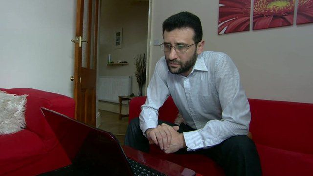 Haytham Al-Hamwi, a member of the Syrian community in Manchester, talks to a friend in Syria online