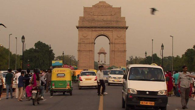 A busy street in Delhi, leading up to the India Gate