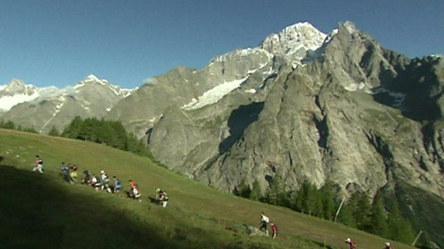 Competitors hike through mountains close to Mont Blanc