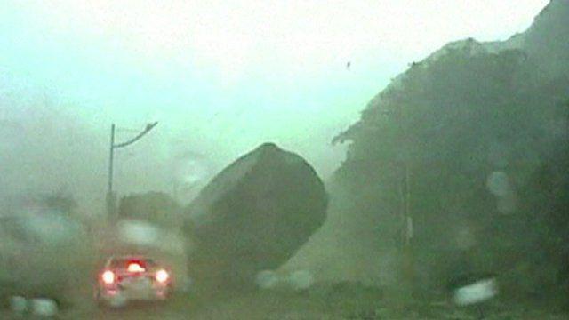 Giant boulder lands near car
